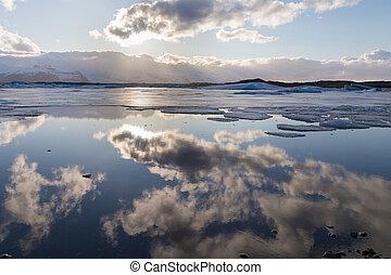 Beautiful Iceland winter season lake with sky reflection
