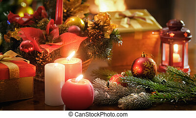 Beautiful image for winter celebrations with burning candles. lanterns and Christmas decorations