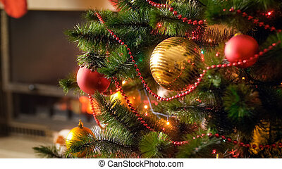 Beautiful image for winter celebrations with decorated Christmas tree against fireplace