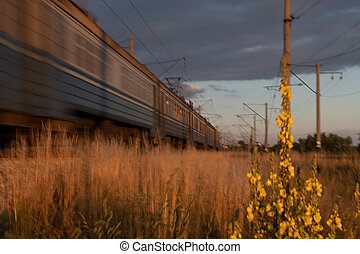train passing at sunset - beautiful image of a train passing...