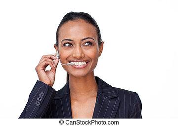 Beautiful Indian businesswoman talking on a headset