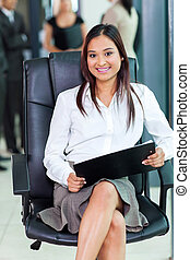 indian corporate worker sitting in office