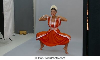 Beautiful Indian girl dancing in national dress