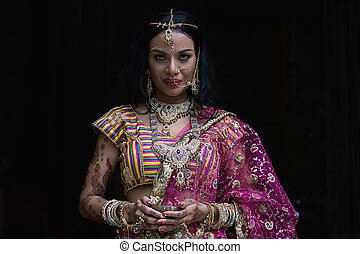 Beautiful Indian Girl in National Dress On a black background