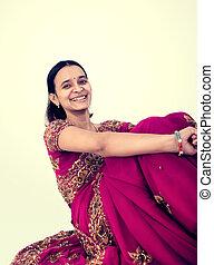 Beautiful Indian happy woman in pin