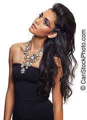 Beautiful indian woman in an evening dress