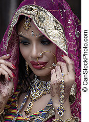 Beautiful Indian woman in National Dress On a black background