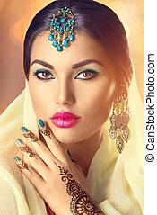 Beautiful indian woman portrait. Hindu girl with menhdi tattoo