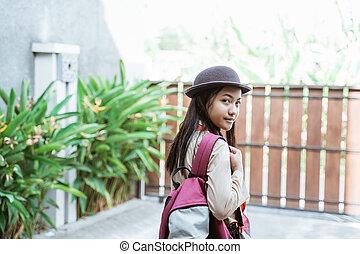 beautiful indonesian junior high school student portrait wearing girl scout uniform