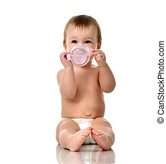 Beautiful infant baby girl toddler sitting in diaper with bottle of water