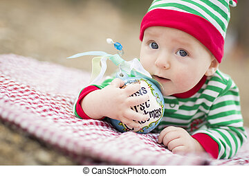 Infant Baby On Blanket With Babys First Christmas Ornament