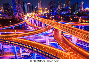 beautiful interchange overpass with light show in shanghai at night