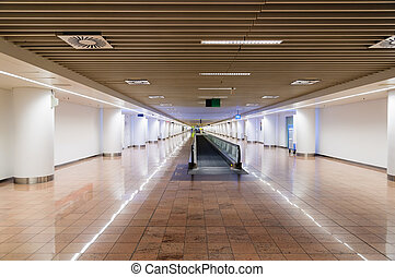 Beautiful interior of a modern terminal in international airport with escalator