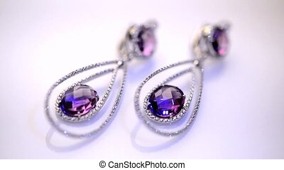 beautiful jewelry with precious stones on a white background