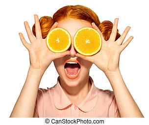 Beautiful joyful teen girl with freckles holding juicy oranges