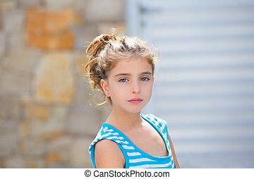 Beautiful kid girl brunette portrait in blue