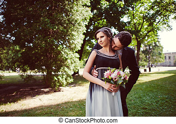beautiful kissing happy couple in love