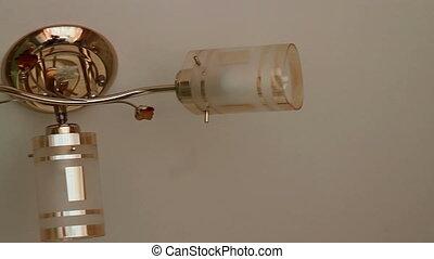 beautiful kitchen chandelier on a cream background.