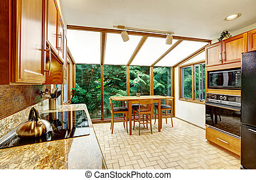 Beautiful kitchen interior. Dining area with transparant glass w