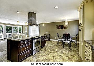 Beautiful kitchen island with granite top and hood