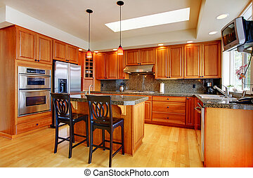 Beautiful kitchen with island, granite and hardwood floor - ...
