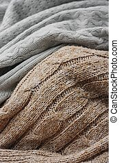 Beautiful knitted grey and brown sweaters macro