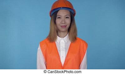 beautiful korean female builder shows hand gesture okey