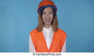 beautiful korean female builder smiling