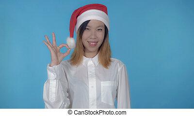 beautiful korean female christmas time shows sign okey