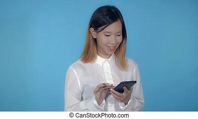 beautiful korean female scrolling mobile