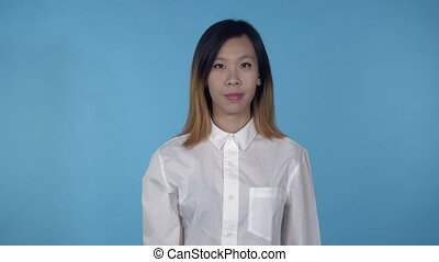 beautiful korean female shows sign knock - young asian woman...