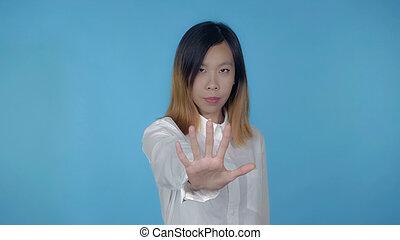 beautiful korean female shows sign stop