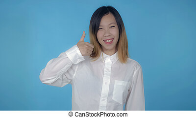 beautiful korean female shows sign thumb up