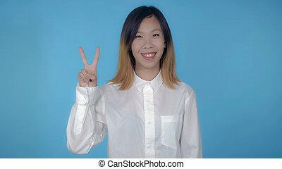 beautiful korean female shows sign win