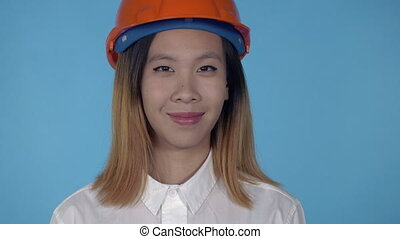 beautiful korean happy builder showing gesture win