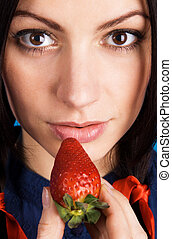 Beautiful lady holding a strawberry