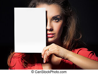 Beautiful lady holding an empty white sheet