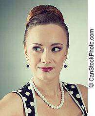 beautiful lady in a polka dot dress.