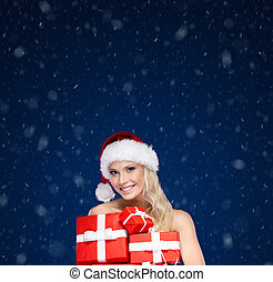 Beautiful lady in Christmas cap holds a set of presents