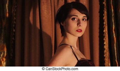 Beautiful lady in elegant evening dress sings - Beautiful...