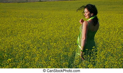 Beautiful lady in green dress is posing for camera