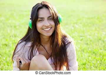 Beautiful lady listening music