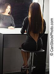 Beautiful lady posing in the studio.