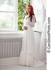 Beautiful lady posing near the window.