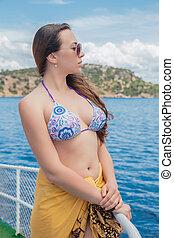 Beautiful lady posing on a yacht