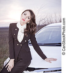Beautiful lady sitting in a car