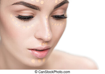 Beautiful lady with concealer on face - Young lovely woman...