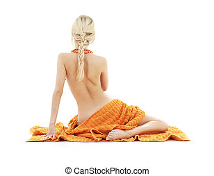 beautiful lady with orange towels over white