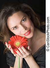 Beautiful lady with red gerber. Portrait