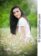 Beautiful lady with wild flowers